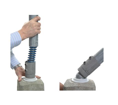Liikennemerkkiputken taipuisa jalusta betoniperustaan