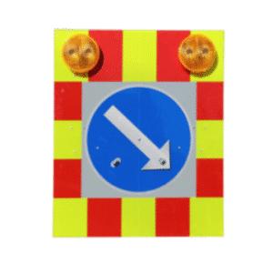 Varoitusaita liikenteenjakajalla ja parivilkuilla lava- tai kuorma-autoon